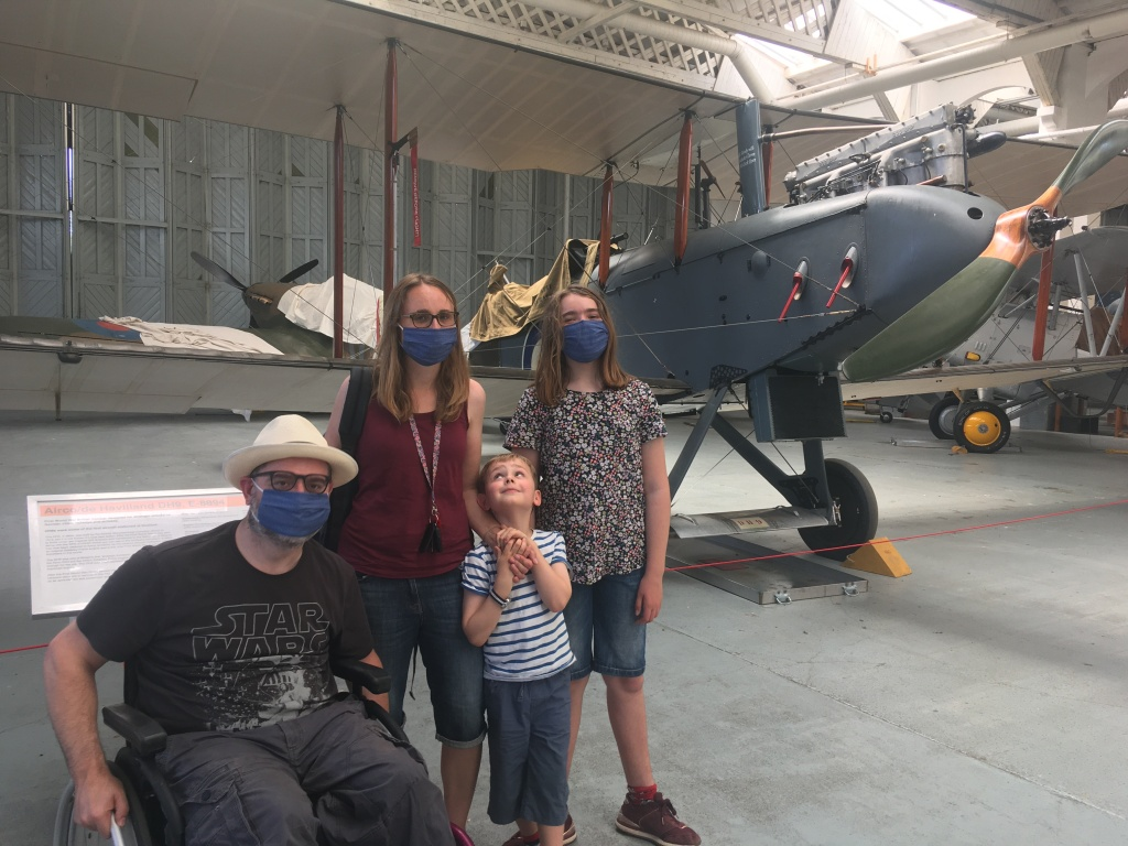 a family of four wearing masks
